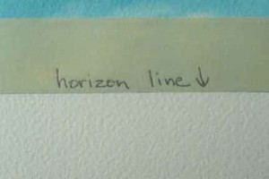Tape over the sky at horizon line.